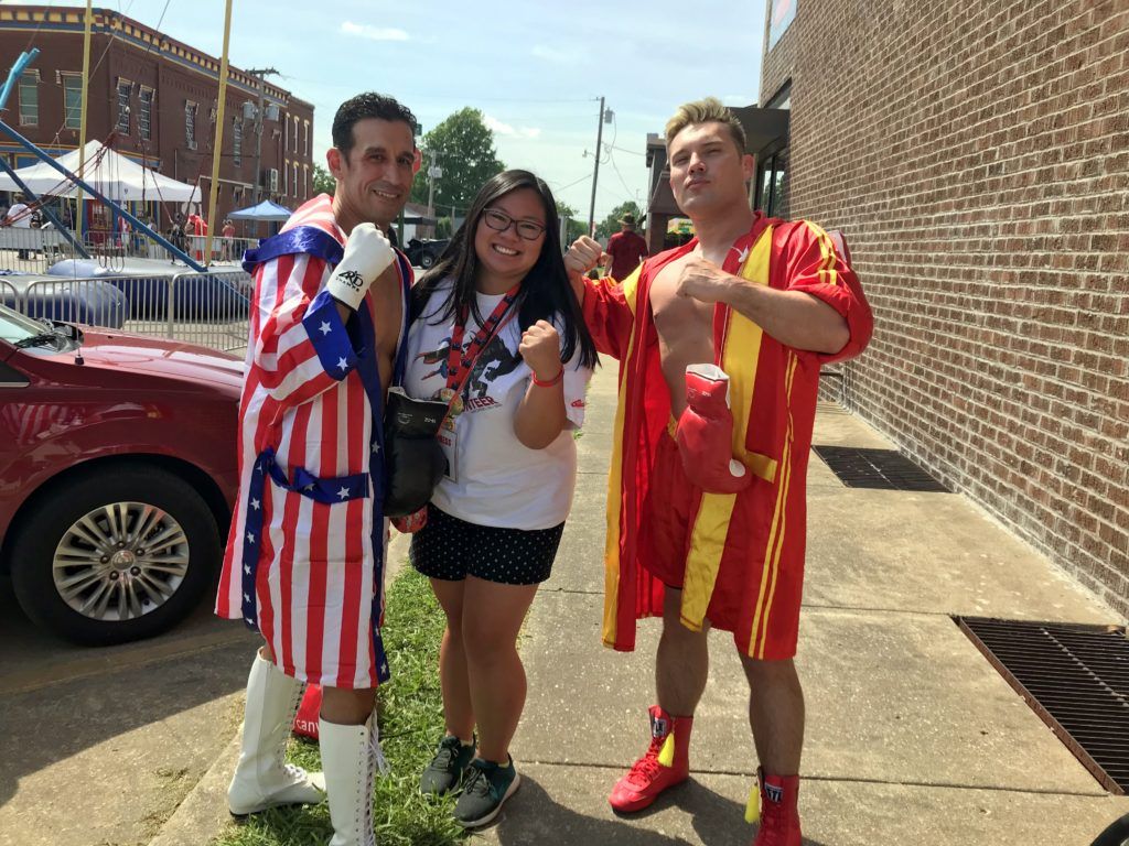 Janine Rinaldi with Ray Martinez (Rocky) and Justin Olinghouse (Drag) dressed up as characters from the Rocky IV movie