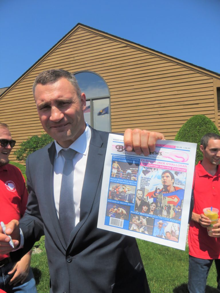 Former Heavyweight Champion and ring great Vitali Klitschko holding The USA Boxing News