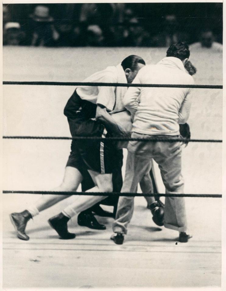 Jack Sharkey being dragged to his corner in Carnera vs Sharkey II