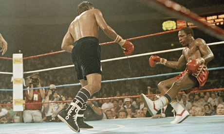 Roberto Duran (L) knocking Davey Moore (R) to the canvas in front of a packed house in Madison Square Garden.
