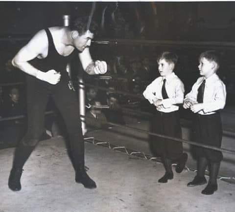 James J. Braddock working out in front of his sons.