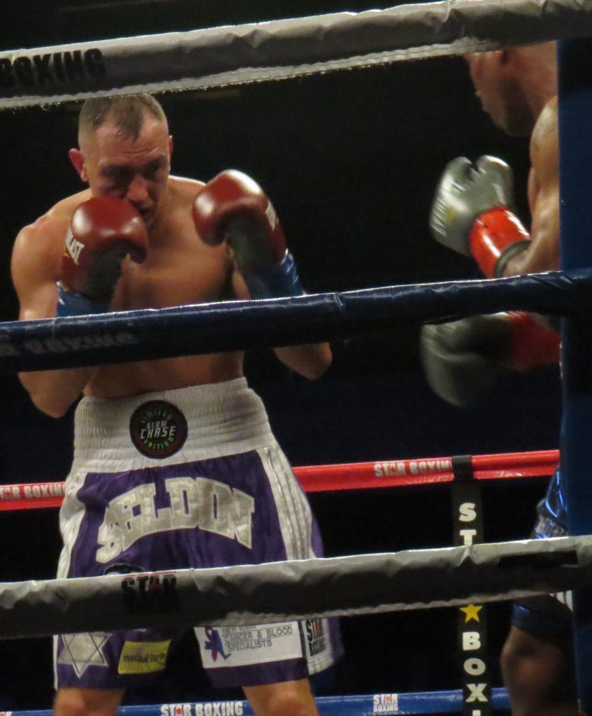 "Cletus ""Hebrew Hammer"" Seldin (L) looks for an opening against former champ Zab ""Super"" Judah"