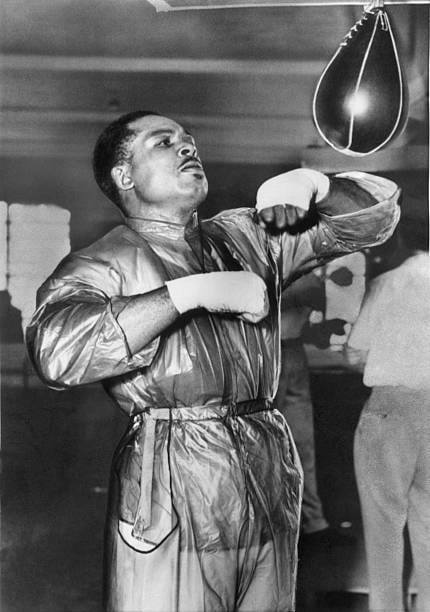 Light Heavyweight Champion Archie Moore trying to shed some pounds in training.