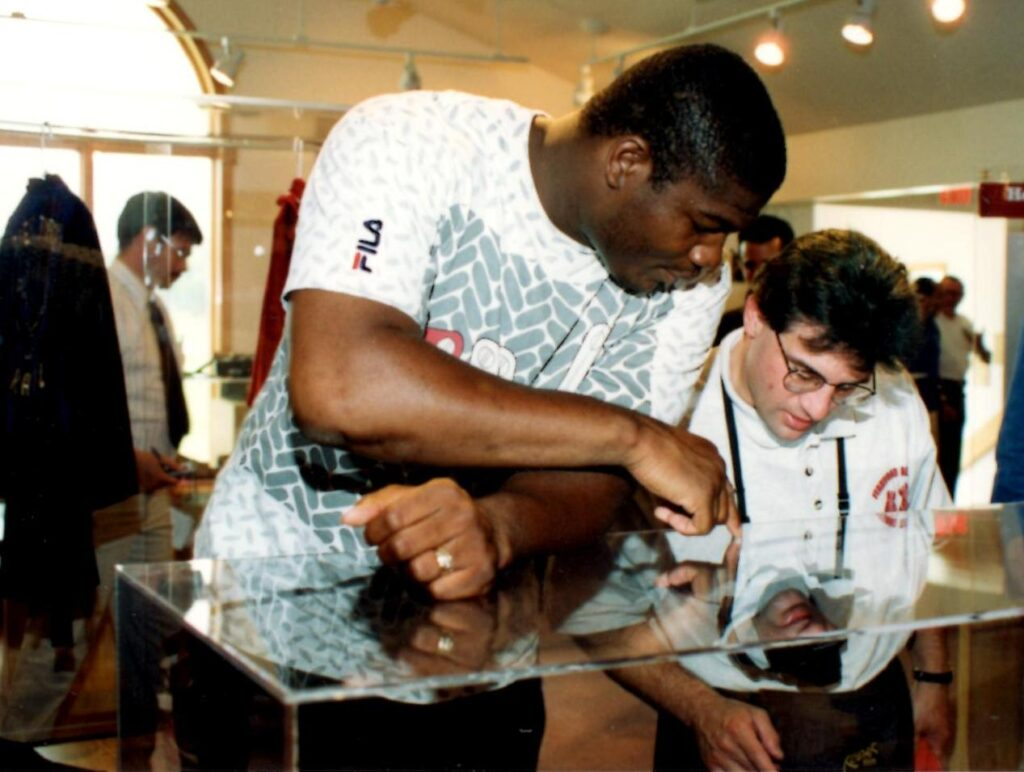 """Heavyweight Champion Riddick """"Big Daddy"""" Bowe showing John Rinaldi some of the artifacts on display at the Boxing Hall of Fame."""