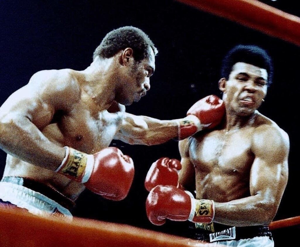 Ken Norton (L)  stabbing Muhammad Ali with a hard left jab in their second fight.