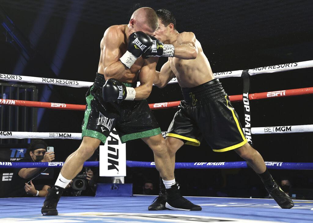 Jose Zepeda (R) slamming Ivan Baranchyk (L). with a jarring left.