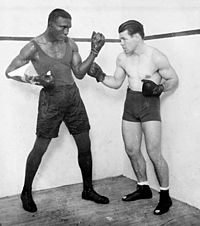 Tiger Flowers (L) and Mickey Walker (R) before their December 3, 1926 title fight at the Chicago Coliseum where Walker dethroned the Middleweight Champion Flowers to win the title.