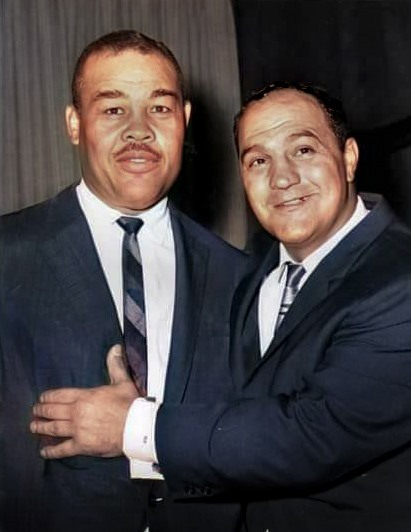 Joe Louis L) and Rocky Marciano R) in the 1960s.
