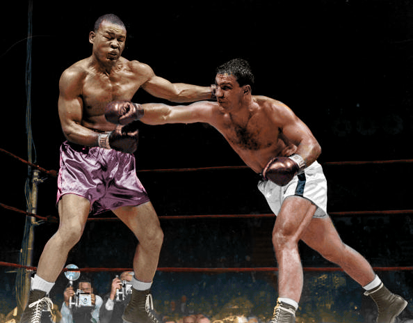 Rocky Marcian (R) nailing Joe Louis (L) with a right to the stomach in their October 26, 1951 bout in Madison Square Garden. Rocky won by TKO in round 8.