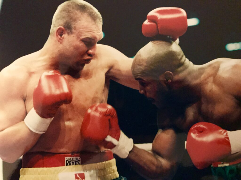 Michael Moorer (R) lands a right to the midsection of Axel Schulz (L) in their bout in Germany for the vacant IBF Heavyweight Title on June 22, 1996, which Moore won by split decision.