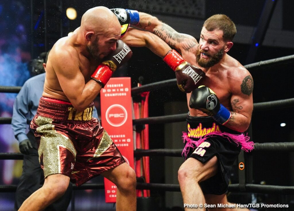 Caleb Plant (R)  planting an overhand right to challenger Caleb Taux's head.