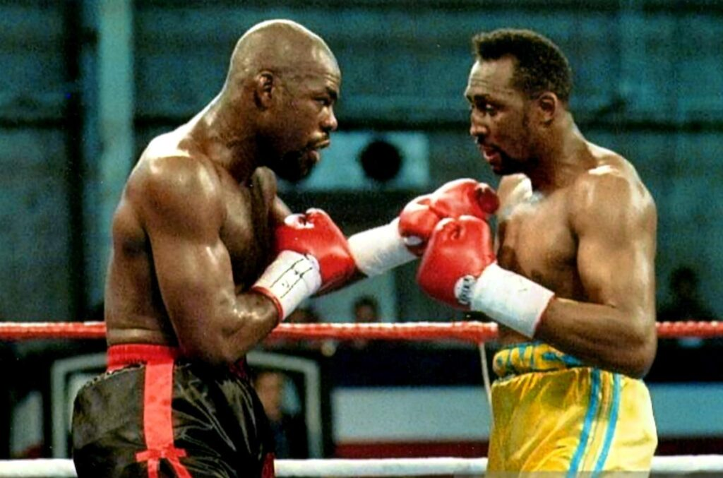 """Iran Barkley (L) scores a split decision win 12 over Tommy """"Hitman"""" Hearns (R) on March 20, 1992 at Caesars Palace, Paradise, Nevada, U.S. to capture the WBA light heavyweight title. (PHOTO BY ALEX RINALDI)"""