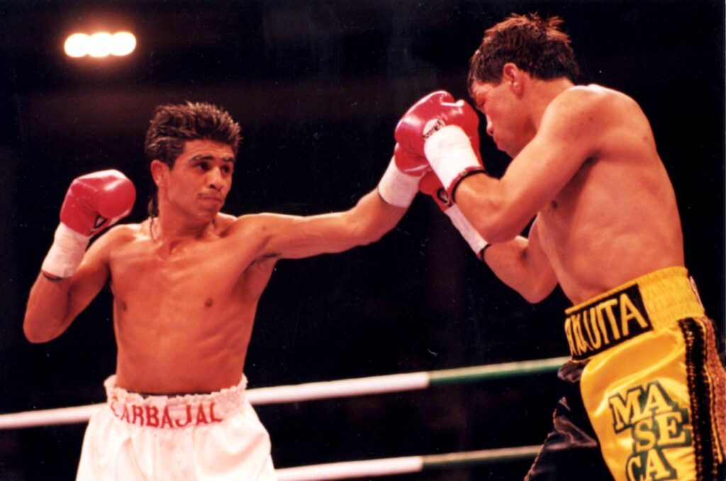 Michael Carbajal (L) KO's Humberto Gonzalez at the Hilton Hotel, Las Vegas, on March 13, 1993 to retain the World Boxing Council (WBC) World Light Fly Title and the International Boxing Federation (IBF) World Light Fly Title. (PHOTO BY ALEX RINALDI)