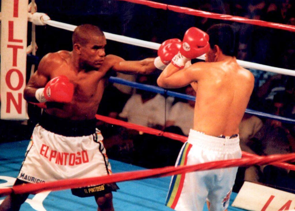 Carlos Murillo (L) defeats Carlos Murillo (R) at the Las Vegas Hilton, Las Vegas, Nevada, to capture the vacant International Boxing Federation (IBF) World Light Fly Title. (PHOTO BY ALEX RINALDI)