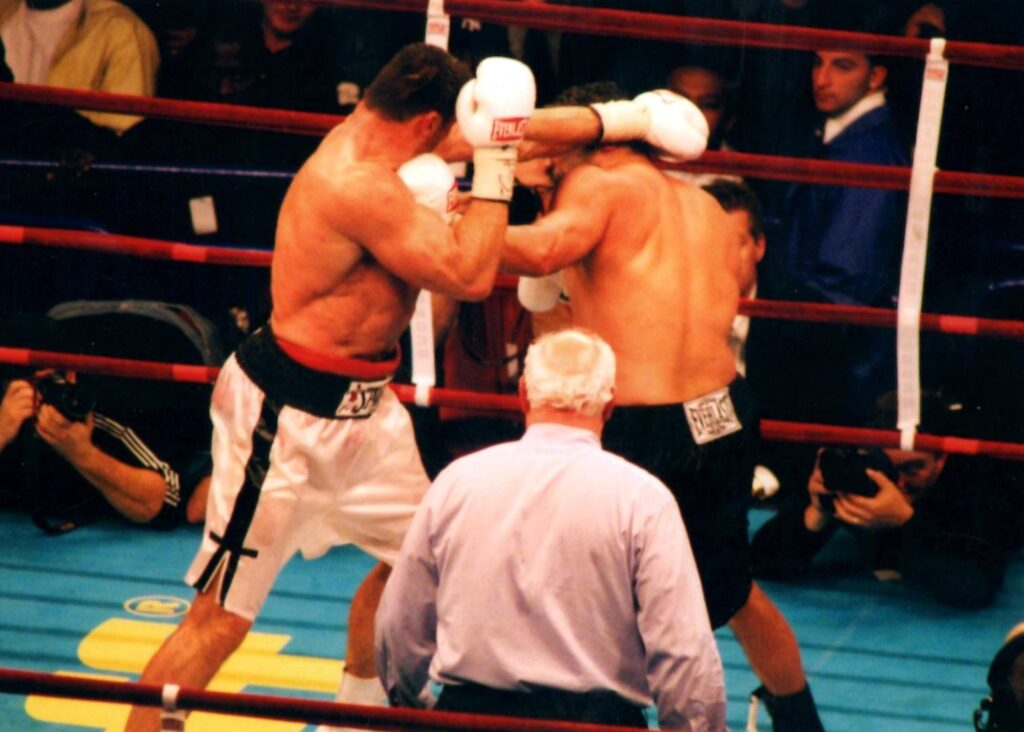 John Ruiz (R) in black trunks defeats Poland's Andrew Golota by UD12 on November 13, 2004at Madison Square Garden, New York City, New York, and retained WBA heavyweight title. (PHOTO BY ALEX RINALDI)