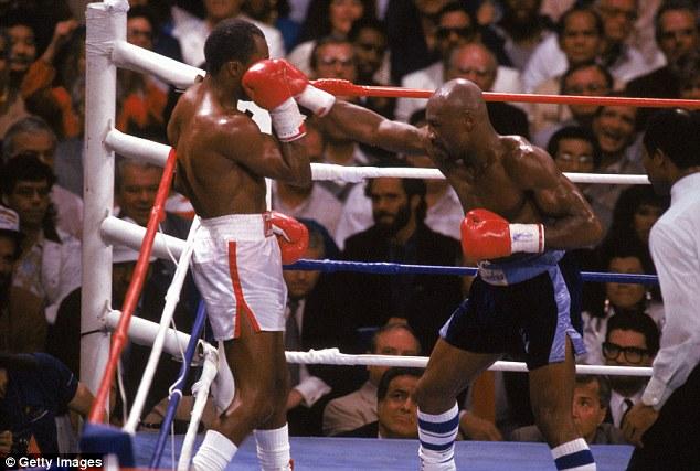 MMarvelous Marvin Hagler (R) fires a hard right through Sugar Ray Leonard's defenses.