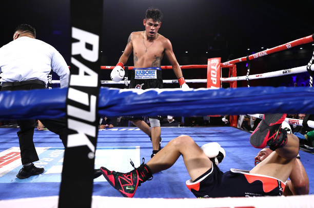 KISSIMMEE, FLORIDA – APRIL 24: Emanuel Navarrete knocks-down Christopher Diaz during their fight for the WBO featherweight title at the Silver Spurs Arena on April 24, 2021 in Kissimmee, Florida.
