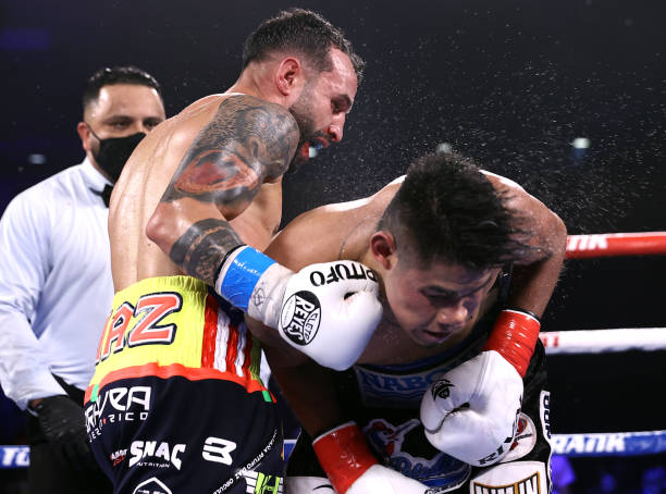 Emanuel Navarrete and Christopher Diaz exchange punches during their fight for the WBO featherweight title at the Silver Spurs Arena on April 24, 2021 in Kissimmee, Florida.