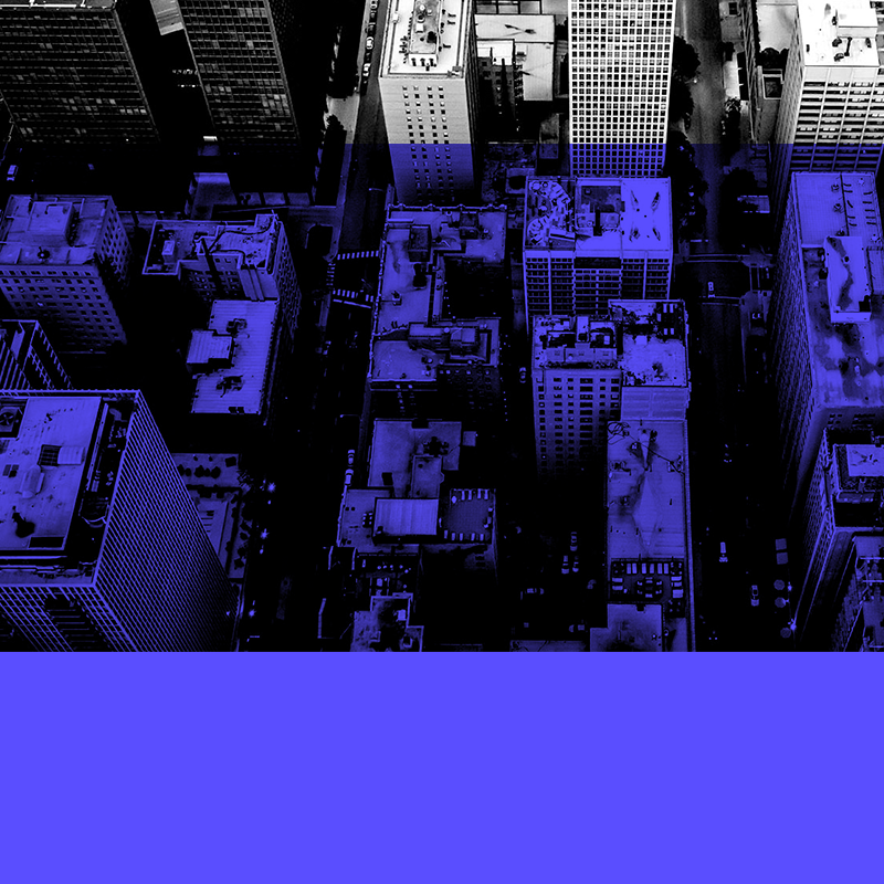 Black and white aerial shot of a Chicago neighborhood with blue block overlay.