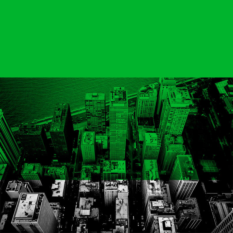 Black and white aerial shot of a Chicago neighborhood with green block overlay.