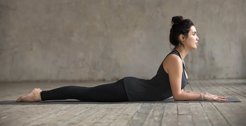 Young woman doing Sphinx exercise