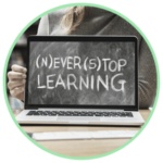 Icon for Online Community Education classes - a laptop with a photo of a chalkboard wording Never Stop Learning