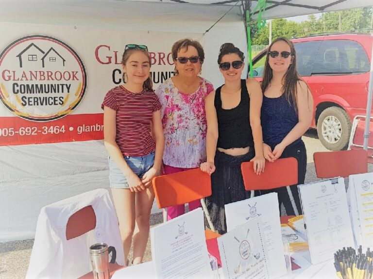 Judy with student volunteers at the Binbrook Farmers Market