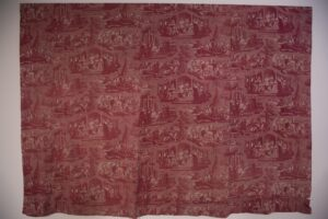 Cotton fabric dyed red and printed with copper plates: three panels sewn together and hemmed at bottom 76 x 104 in.