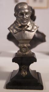Spelter reliquary bust on wooden pedestal 9 1/2 x 4 1/4 x 4 1/4 in.