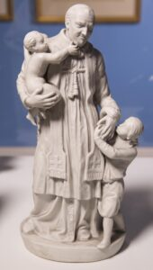 Bisque porcelain statue 15x 4 1/2 x 7 1/2 in.