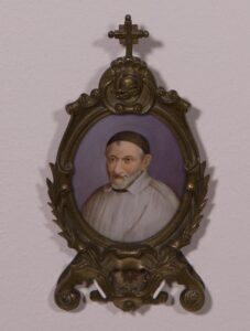 Cast bronze oval reliquary with painted portrait on porcelain 6 1/2 x 3 1/2 in.