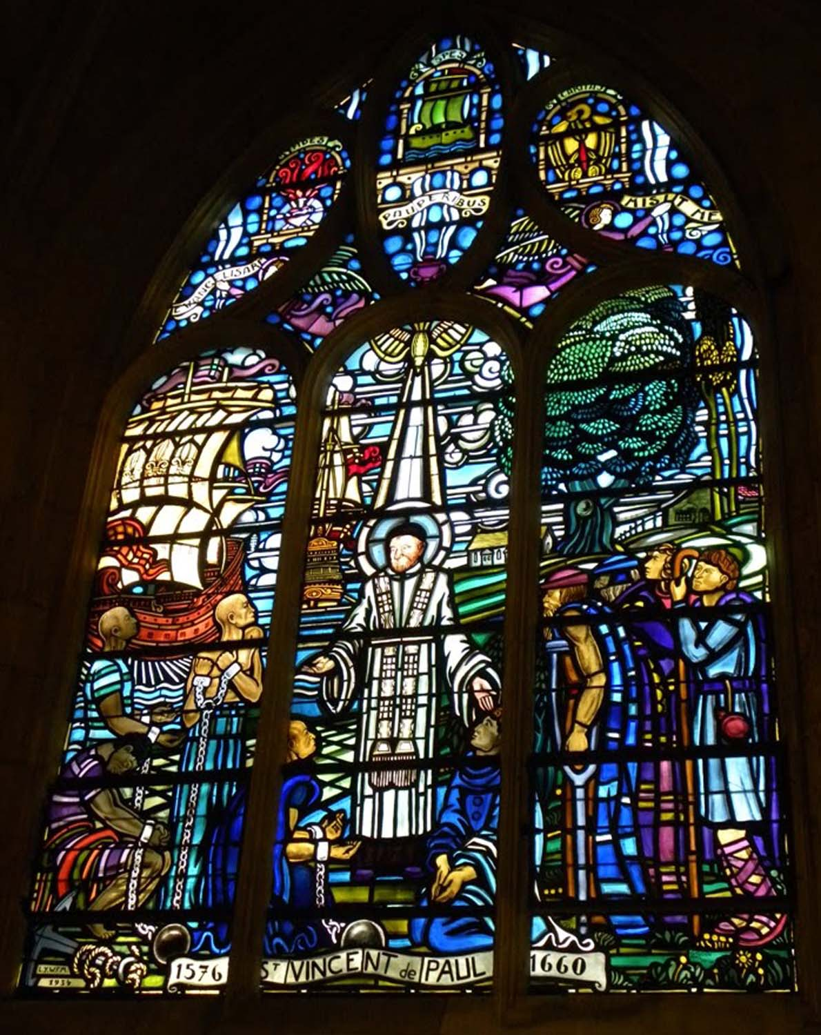 The stained glass windows honoring Saint Vincent and Saint Louise.