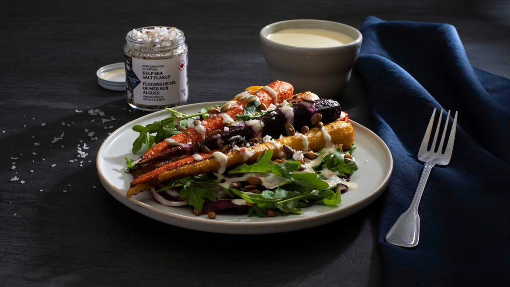 Heirloom carrots on a bed of healthy salad greens drizzled with a creamy, citrus yogurt dressing