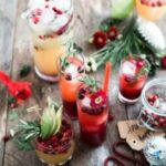 Holiday Drinks with Red and Green fruit and greenery