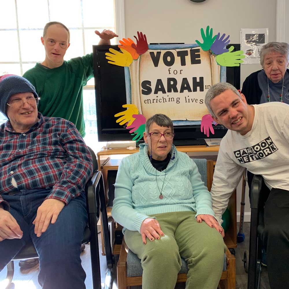 North Haven Adult Attendees holding Vote for SARAH Signs