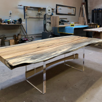 Tamarind wood dining table with acrylic panel legs and punch through trestle