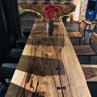 Single plank Mango dining table with trimmed edge