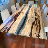 Book matched Tamarind dining table with blue glass river inlay