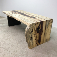 Live edge Tamarind desk with steel panel leg and waterfall end