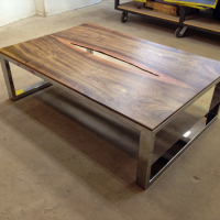 Bookmatched Walnut coffee table with live edge center and mirror polished stainless steel base