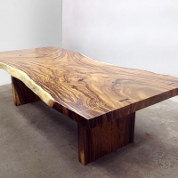 Live edge Acacia dining table with trimmed edge and slab panel legs