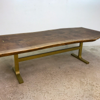 Single plank live Walnut dining table with powder coated T-base and brass butterflies