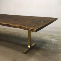 Single plank live edge Walnut dining table with cast bronze T-base and matching butterflies