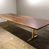Walnut dining table - bookmatched - on polished bronze base - bronze butterflies