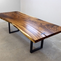 Acacia dining table with black and gold steel base