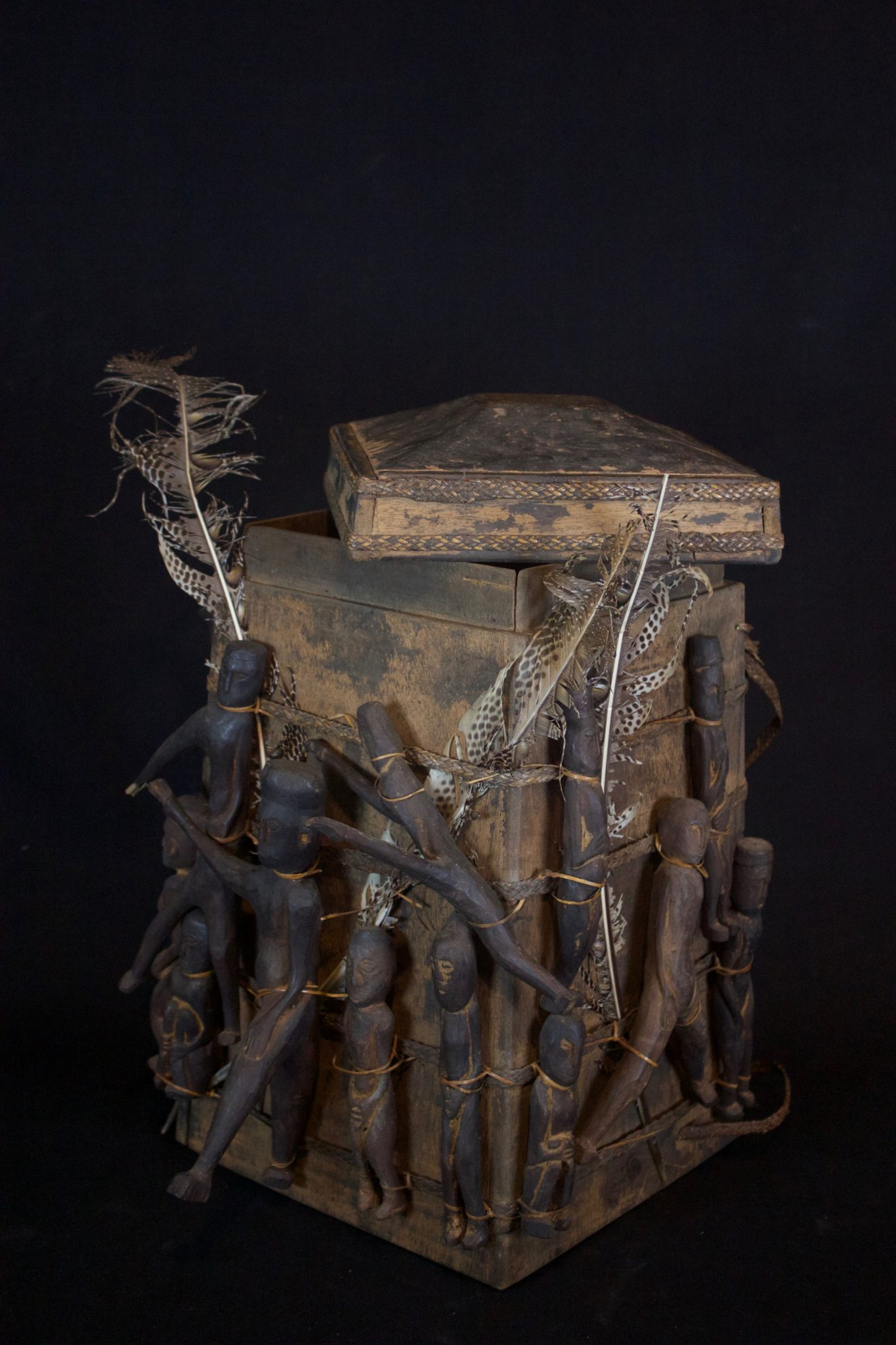 """'Lupong Manang' or Shaman's Medicine Carrier/Backpack with Healing Amulet/Fetish Figures (rare), East Kalimantan, Borneo, Indonesia, Dayak tribe, Late 19th to early 20th c, Wood pigmented with soot, raffia, feathers, porcupine quill Shaman made their own medicine kit backpacks to carry items for healing, protection and predictions such as special teeth, stones and other items. The healing amulet figures on the exterior correspond to illnesses and other conditions. 17"""" x 12 ½"""" x 15"""", $3,900. (see below image for detail image of shoulder straps)"""