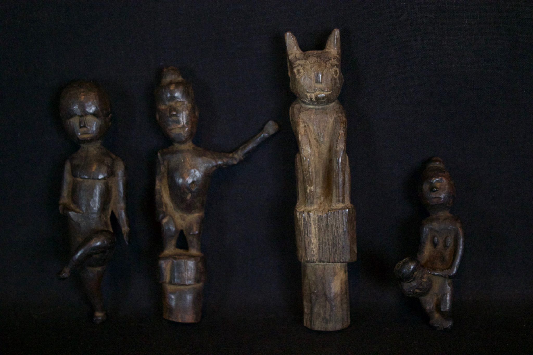 """Shaman's Amulet/Talisman Figures for Healing, Kalimantan, Borneo, Indonesia, Dayak tribe. Dimensions/Info Left to Right: (Early 20th c. Wood, 4 ¾"""" x 1 ½"""" x 1 ½"""", $90.); (Late 19th to early 20th c, Wood, 5"""" x 2 ½"""" x 1 ½"""", $90.); (Mid 20th c, Wood, Stopper for shaman's medicine container, 5 ¾"""" x 1"""" x 1 ¼"""", $130.); ( Early 20th c. Wood, Used for healing a child, 3 ¼"""" x 1"""" x 1 ¾"""", $85.)"""