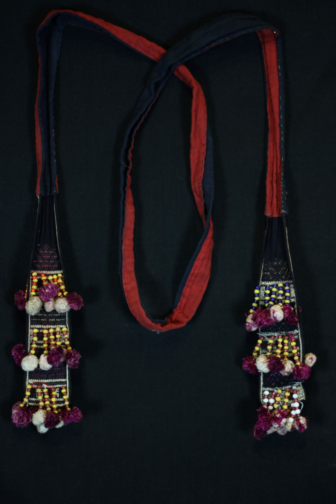 """Shaman Costume Belt, Vietnam, Mid 20th c, Cotton, embroidered with silk, glass beads, Part of shaman's costume. 69 ½"""" x 3"""" x 1"""", $180"""