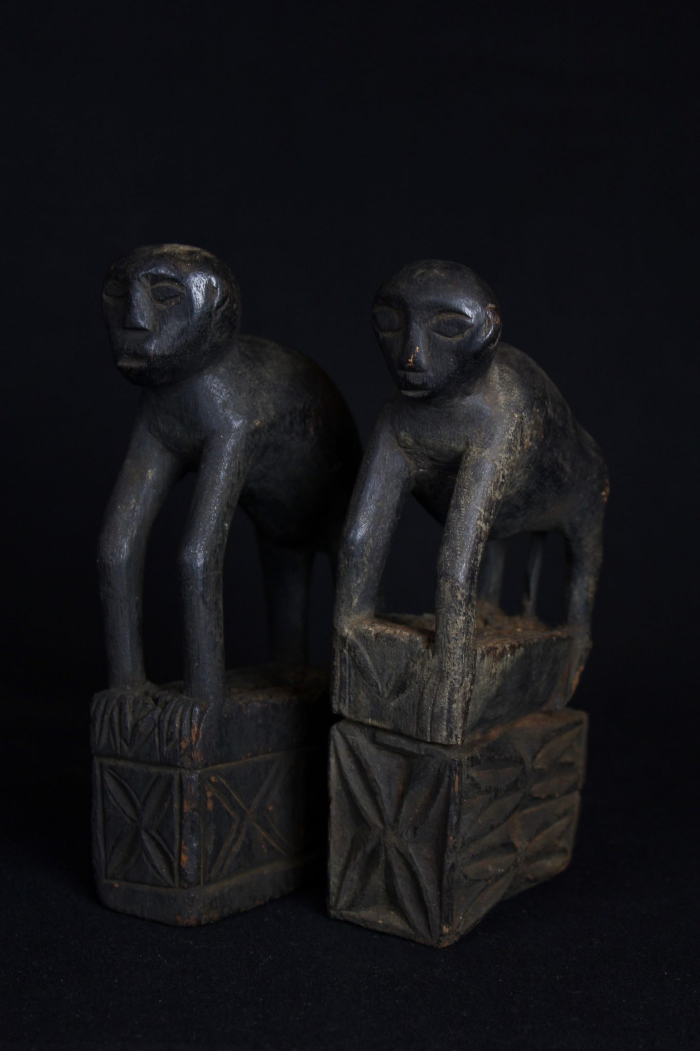 """Shaman Amulet/Talisman Figure (rare), Kalimantan, Borneo, Indonesia, Modang Dayak tribe, Early to mid 20th c, Wood with patina from use and age. Zoomorphic or monkey figure amulet. $650 (sold as pair) Dimensions"""" (left - 7"""" x 1 ½"""" x 3 ¾""""); (right - 7"""" x 1 ½"""" x ¾"""")"""