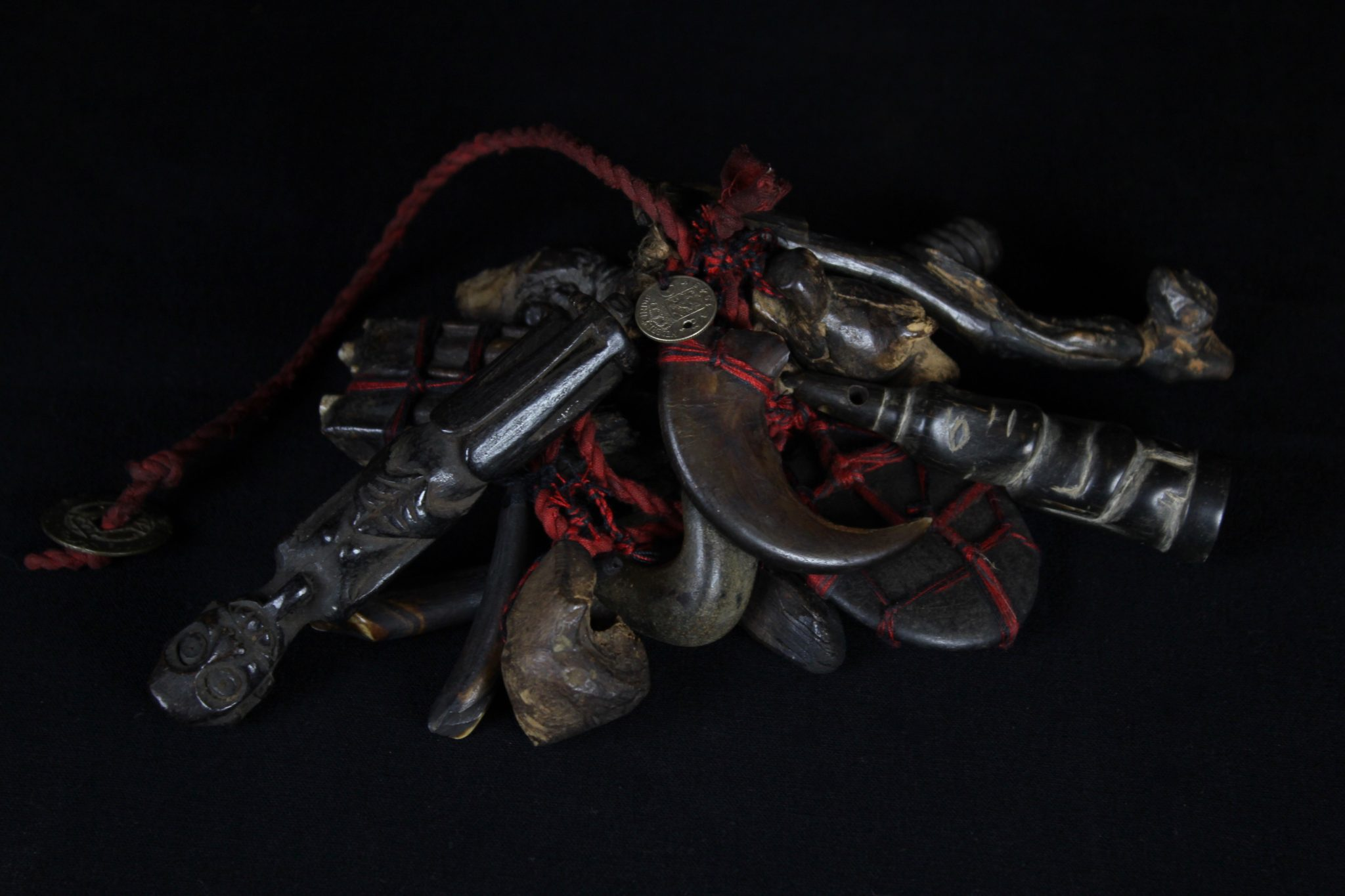 """Shaman Healing Fetish Rattle Borneo, Indonesia, Dayak tribe, Early 20th c, Wood pigmented with soot, stone, animal teeth and claws, coins, patinated with age and use. Used for healing rituals. 14"""" x 8"""" x 4"""", $560."""
